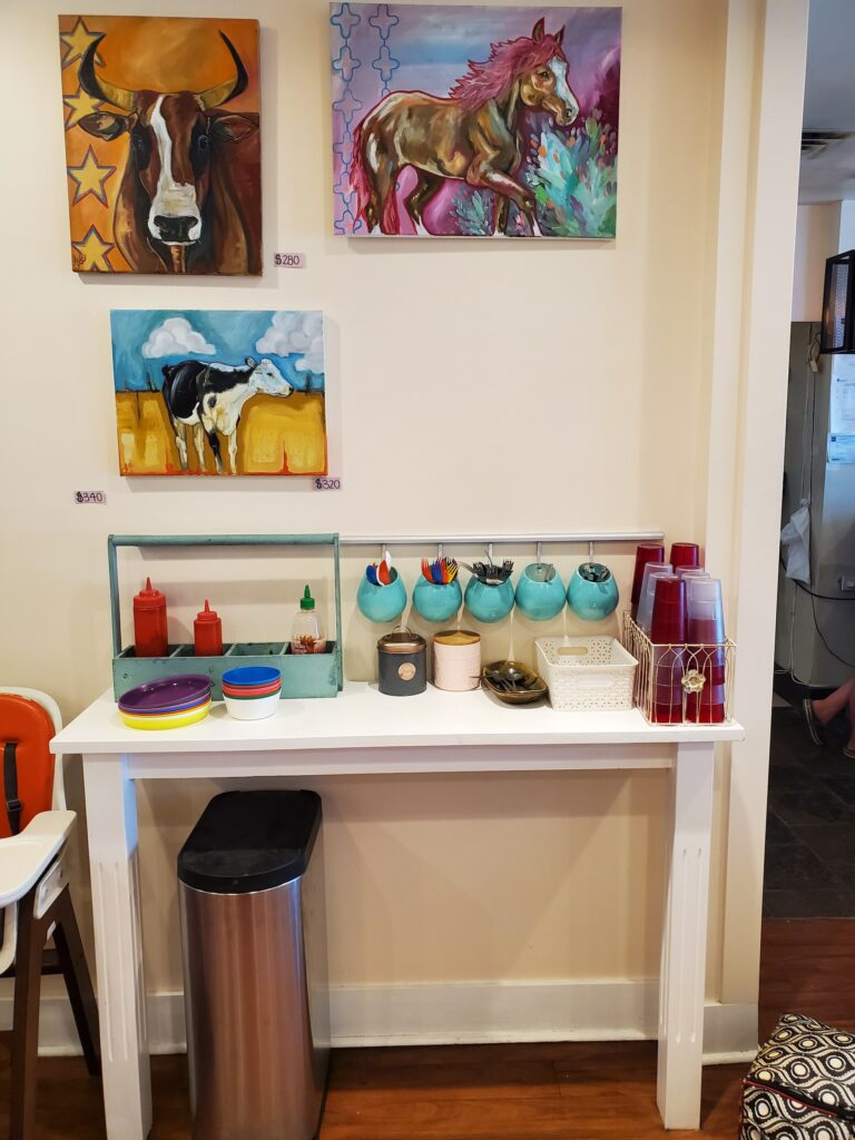 Coffee station with colourful animal paintings above